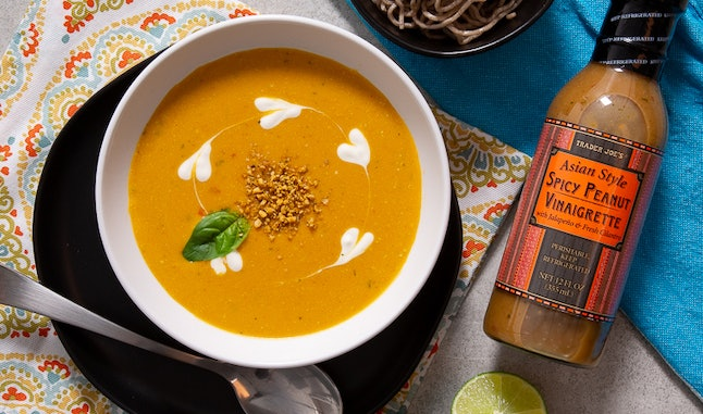 Turn Trader Joe's Spicy Peanut Vinaigrette into a thai-style peanut pumpkin soup.