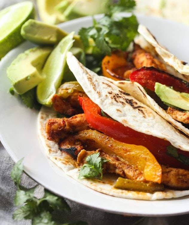 The sheet pan fajitas from Cookies and Cups are made in a baking sheet