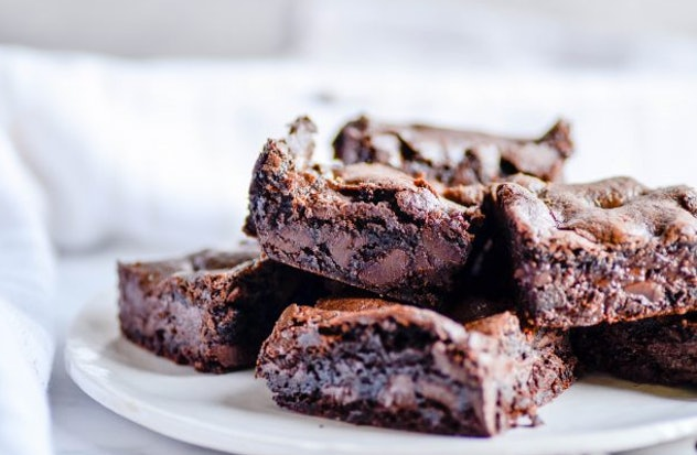 fudgy chocolate chunk brownies recipe from Something Swanky is a rich and flavorful dessert