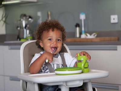 a toddler sitting in the OXO Tot Sprout highchair
