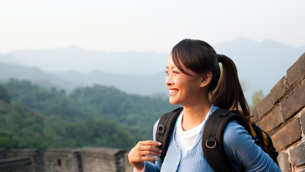 Young Asian woman hiking, Great Wall of China
