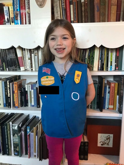 A girl wearing a girl scout uniform.