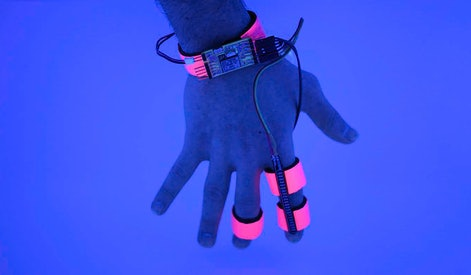 A hand equipped with the Dormio glove prototype.