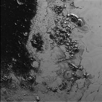 Scientists solved the mystery behind Pluto's snowcapped mountains