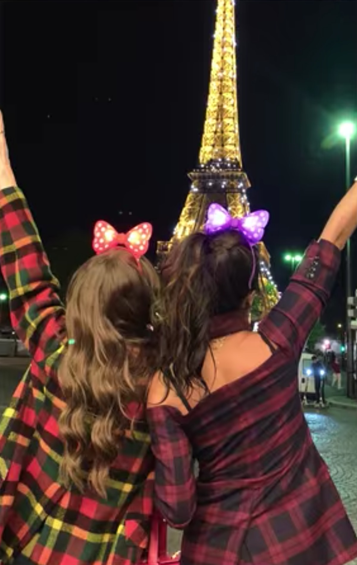 Emily (Lily Collins) and Mindy (Ashley Park) look out at the Eiffel Tower in Paris.