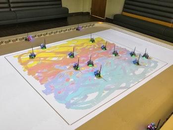 tiny robot swarm painting