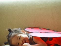 child wearing ladybug costume