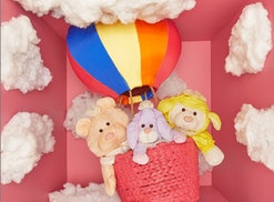 """Fisher-Price toy museum photo of three """"Puffalump"""" toys in a mini hot air balloon"""