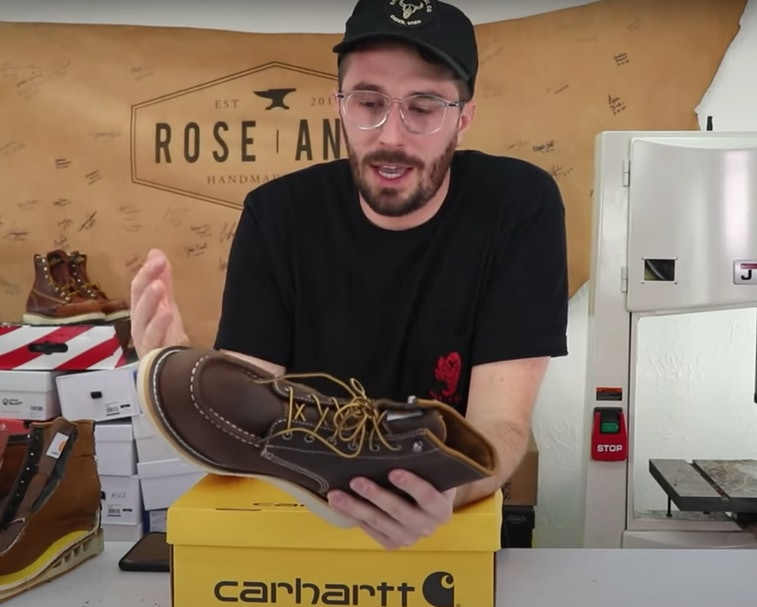 YouTuber Weston Kay on his channel reviewing a leather boot and then cutting it up.