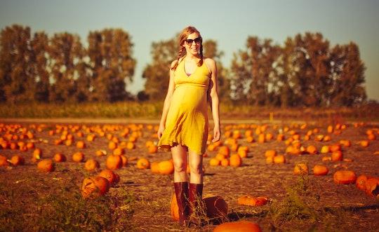 pregnant woman in a pumpkin patch