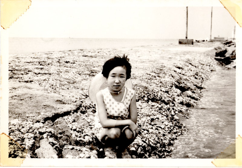 "Photo of Kansho Aizawa as a child in Unsolved Mysteries' ""Tsunami Spirits."""