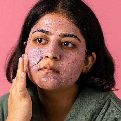Model applying the Lush Beauty Sleep Face and Body Mask.