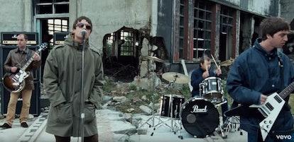 Oasis wearing parkas, performing in their music video