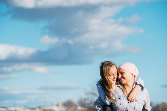 mom, breast cancer survivor, and daughter laughing