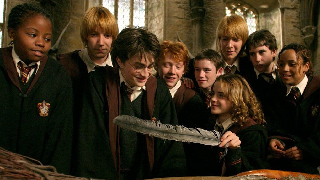 Harry Potter and his friends look at a gift with a feather in it from 'Harry Potter and the Prisoner of Azkaban.'