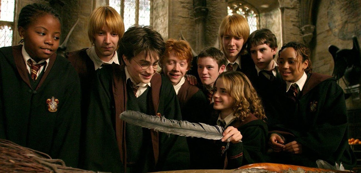 Harry Potter and his friends look at a gift with a feather in it from 'Harry Potter and the Prisoner...