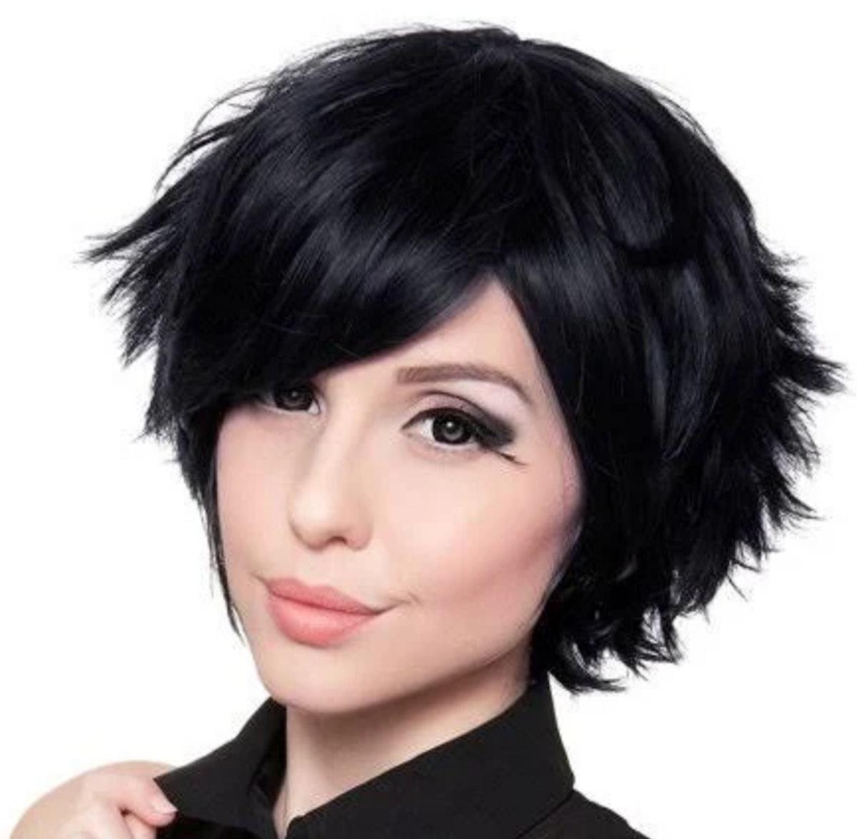 Moira Rose wears a short black wig to play Dr. Clara Mandrake on 'Schitt's Creek.'