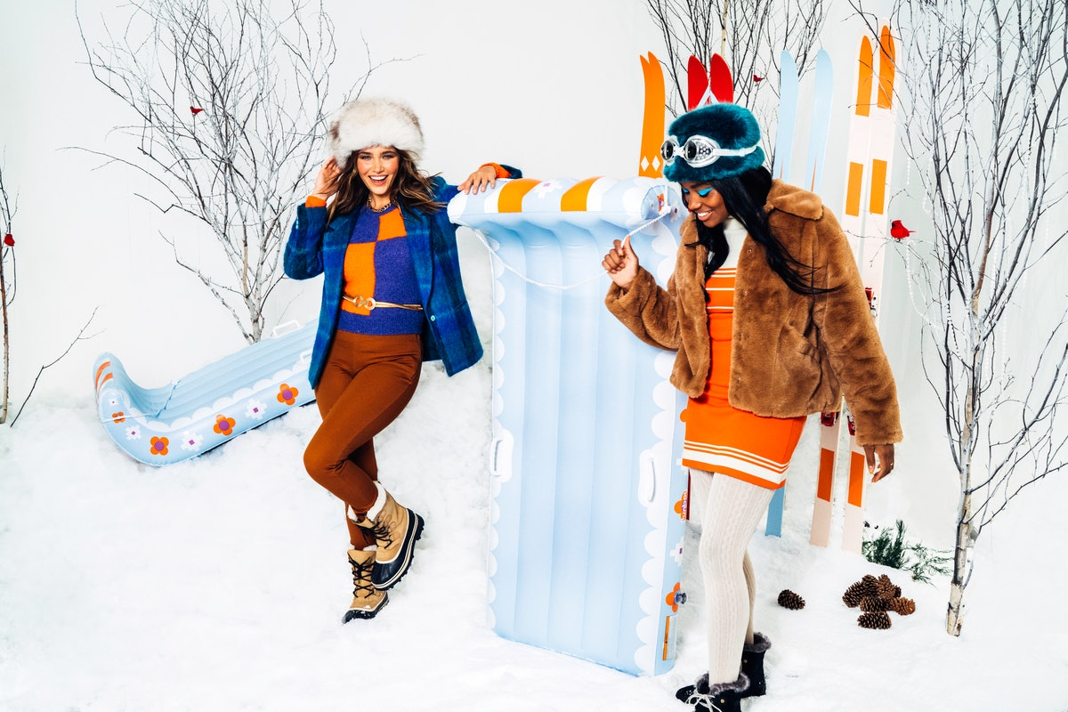 Two young women pose next to new pieces from the FUNBOY winter 20/21 SNOW collection while wearing c...