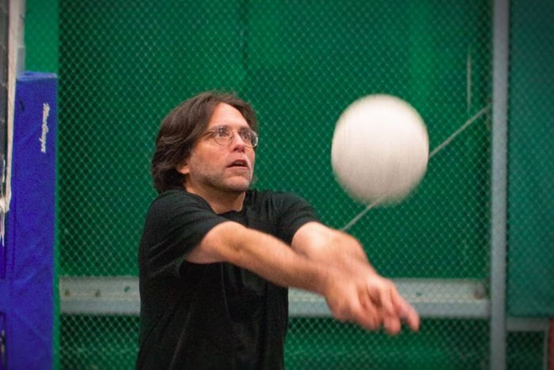 Screenshot from HBO's The Vow of NXIVM founder Keith Rainere playing volleyball.