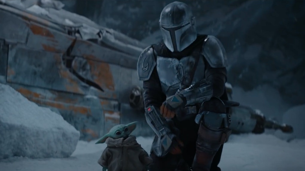 In the season two trailer for 'The Mandalorian,' Mando kneels next to The Child in a snowy town.