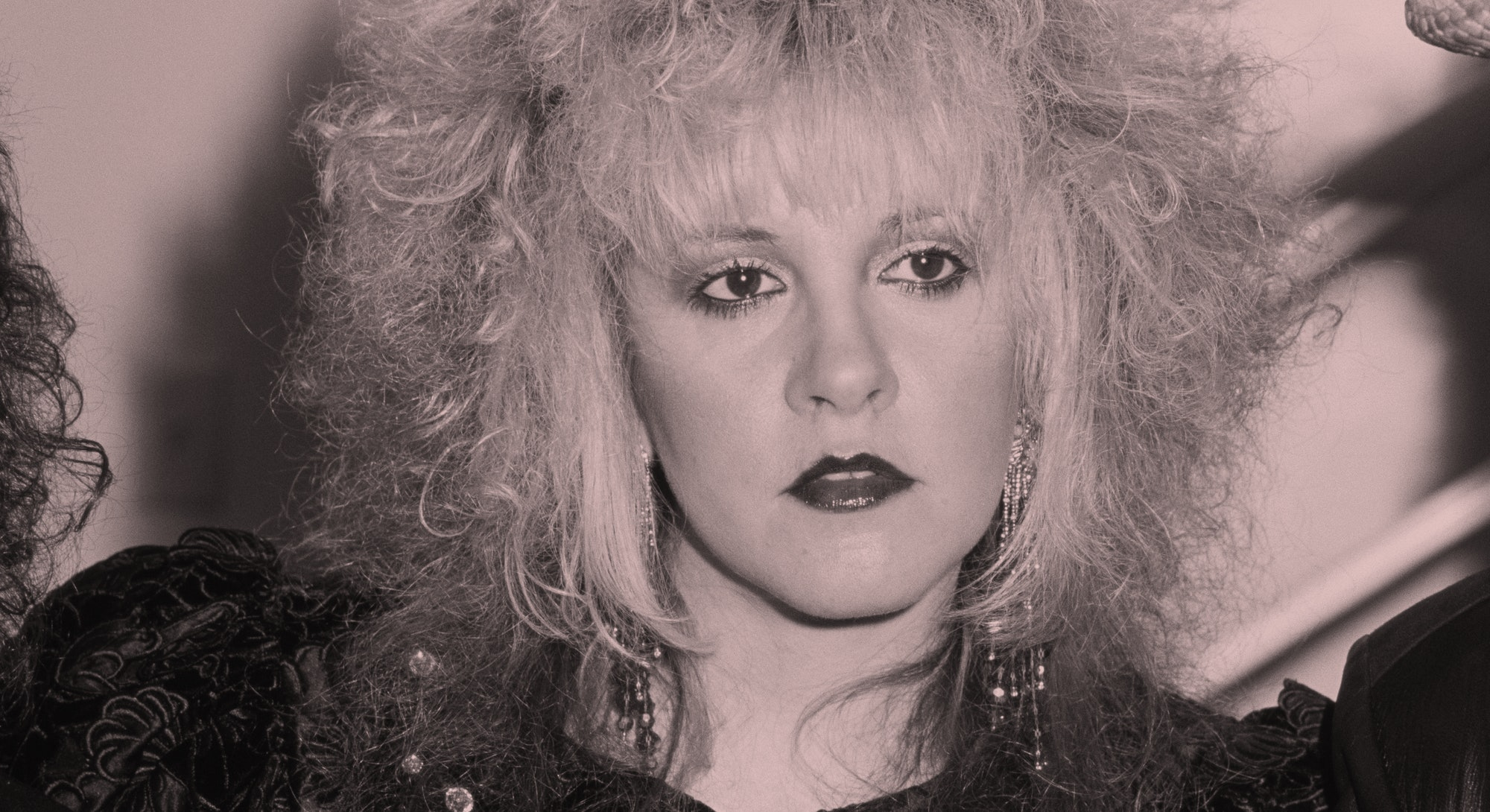 Stevie Nicks with blonde hair that's streaked red.