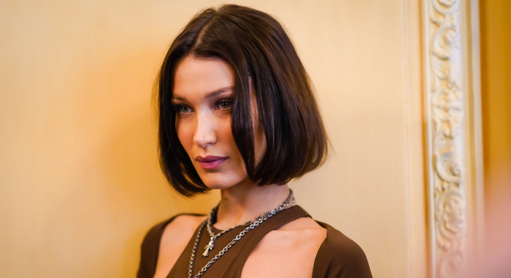Model Bella Hadid with a middle-part brown bob.