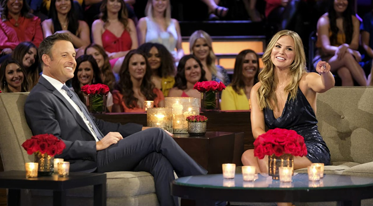 Chris Harrison and Hannah Brown sit on couches during a special for 'The Bachelorette.'