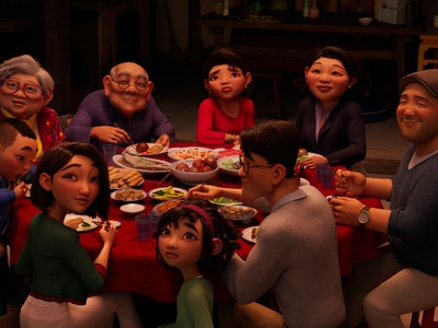 "A still from 'Over The Moon,"" showing a Chinese family sitting around a dinner table. They are all looking up above the viewer's head."