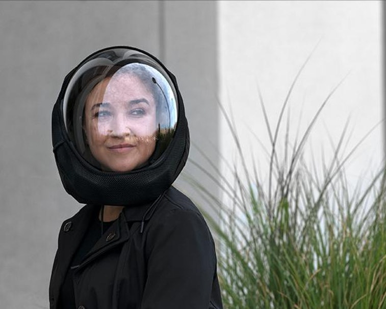Woman wearing AIR helmet outside