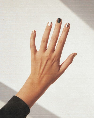J.Hannah x The Met nail polishes on fingers.