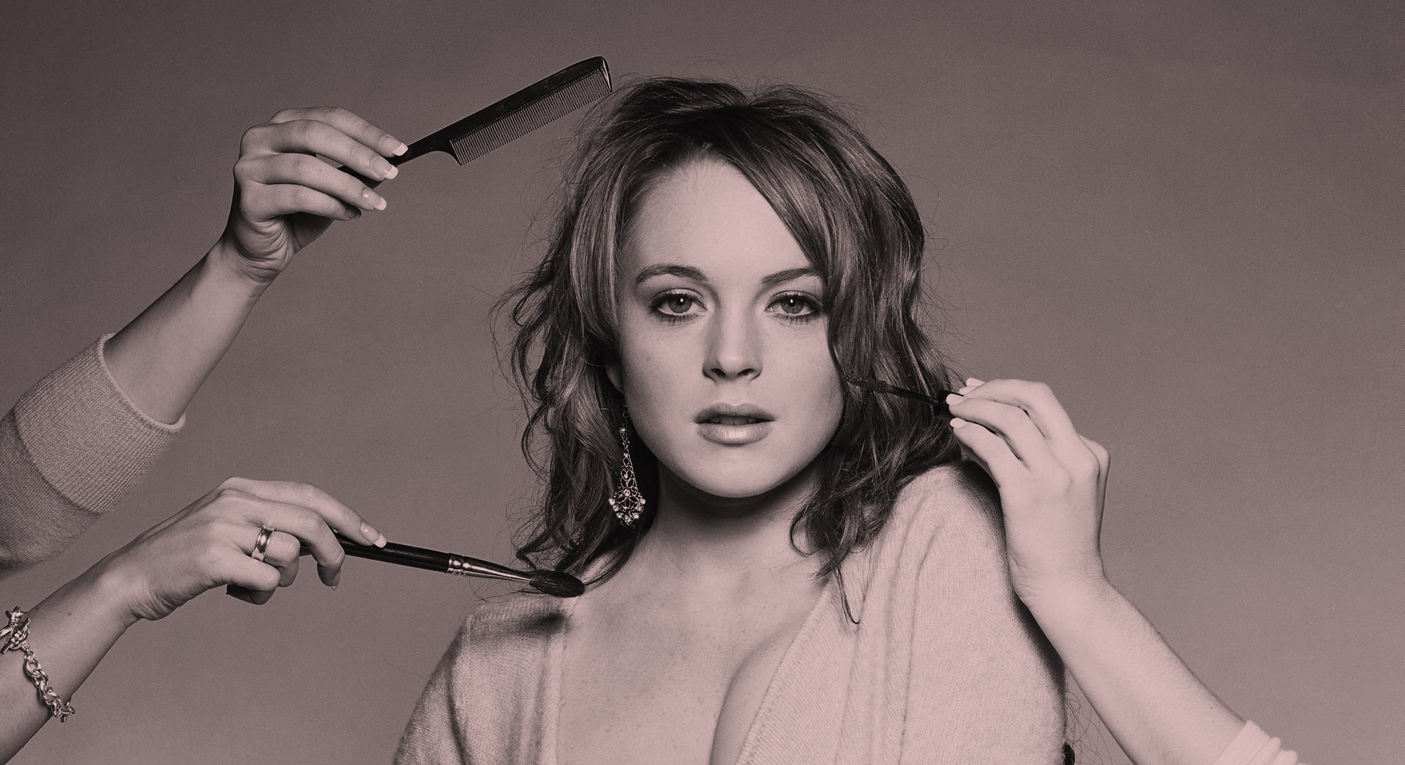 Lindsay Lohan of Mean Girls poses in promotional film image that has her getting a makeover.