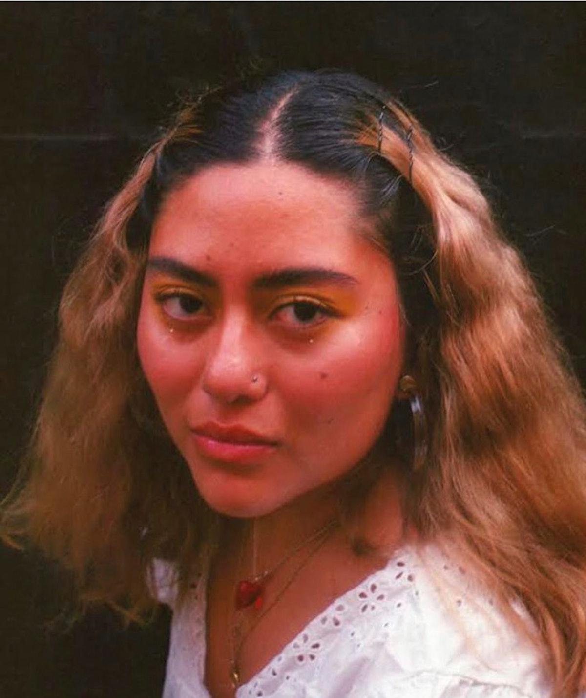 Nereida Ortiz, a DACA recipient, looks directly into the camera