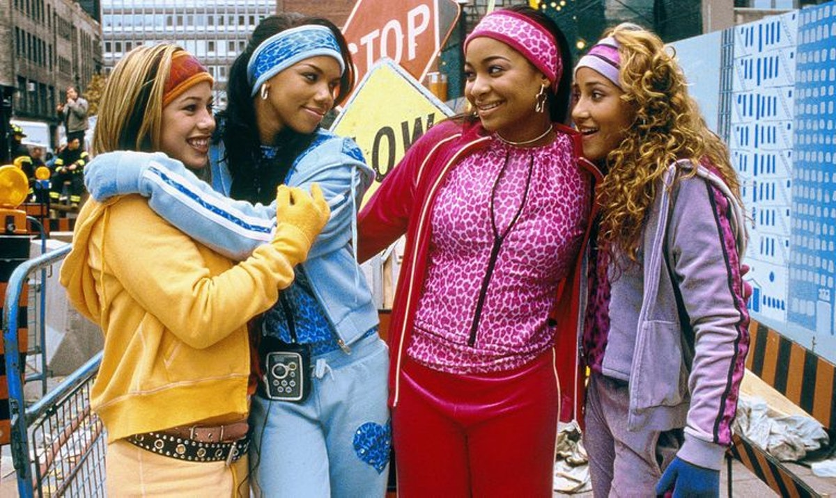 "Sabrina Bryan, Kiely Williams, Raven-Symoné, and Adrienne Bailon in tracksuits in ""Cheetah Girls."""