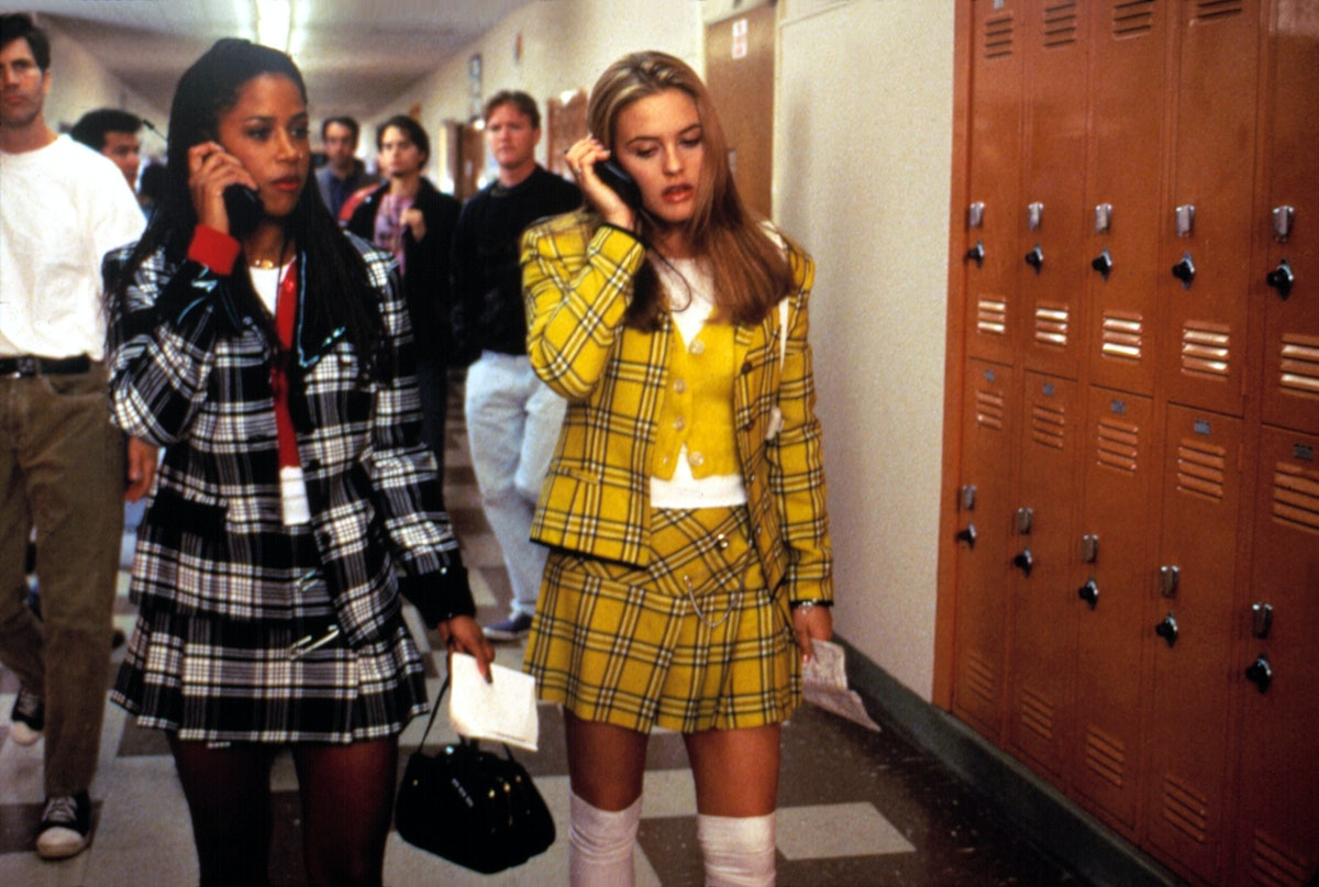 Dionne and Cher walking to class in matching outfits.