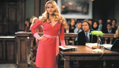 Elle Woods, played by Reese Witherspoon, in court in a pink dress.