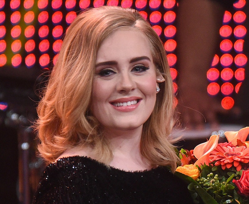 Singer Adele on stage with flowers
