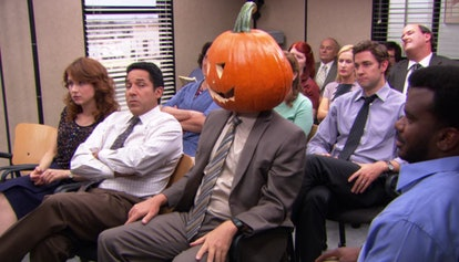 Dwight in a pumpkin head on The Office via a screenshot