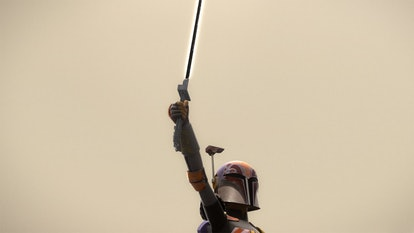 The Mandalorian Sabine Wren holds the Darksaber in an episode of 'Star Wars: Rebels.'