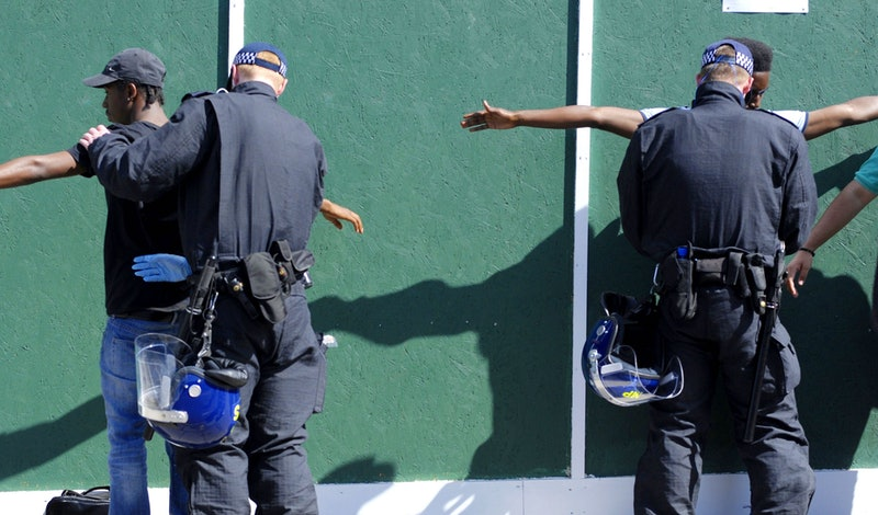 The Met police stop and search two Black men.