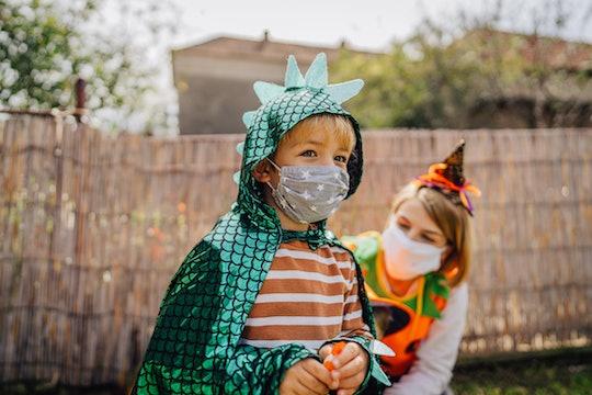little boy in dragon halloween costume