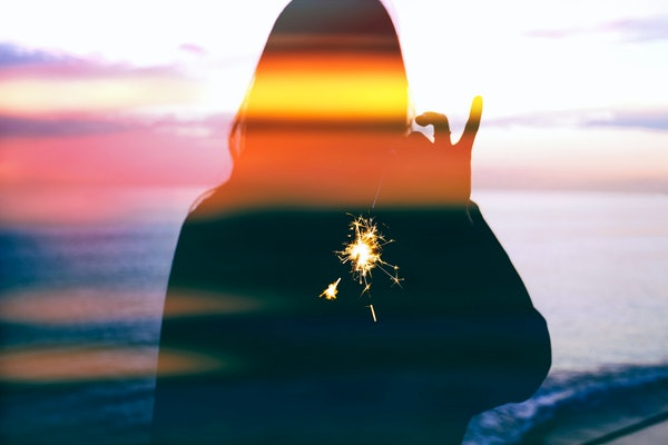 Young woman silhouette, fireworks