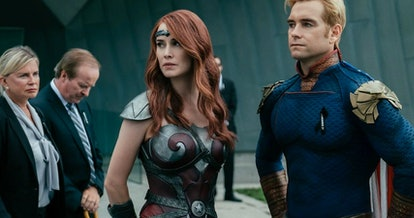 Maeve, a Halloween costume for redheads, stands next to Homelander in their armor.