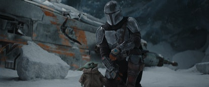Mandalorian and Baby Yoda in 'Mandalorian' Season 2, via Disney+ press site.