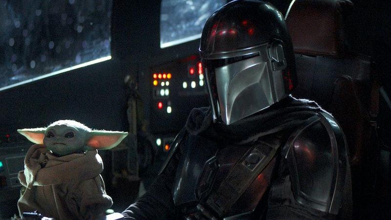The Mandalorian and Baby Yoda in 'The Mandalorian.'