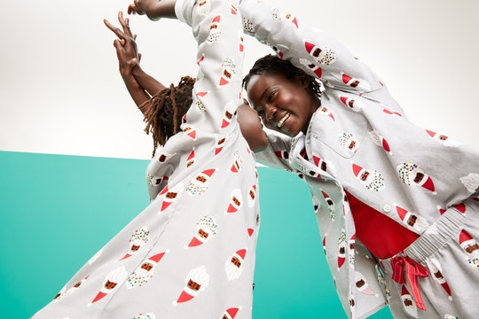 mother and child playing in Santa pajamas