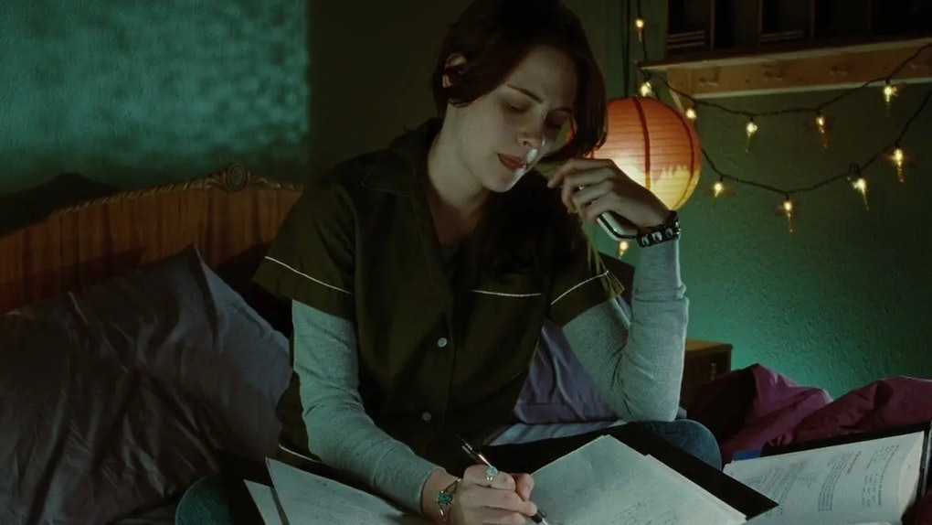 Bella Swan, played by Kristen Stewart, doing homework while on the phone with her mom.