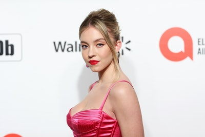 Actress Sydney Sweeney on the red carpet with red lipstick.