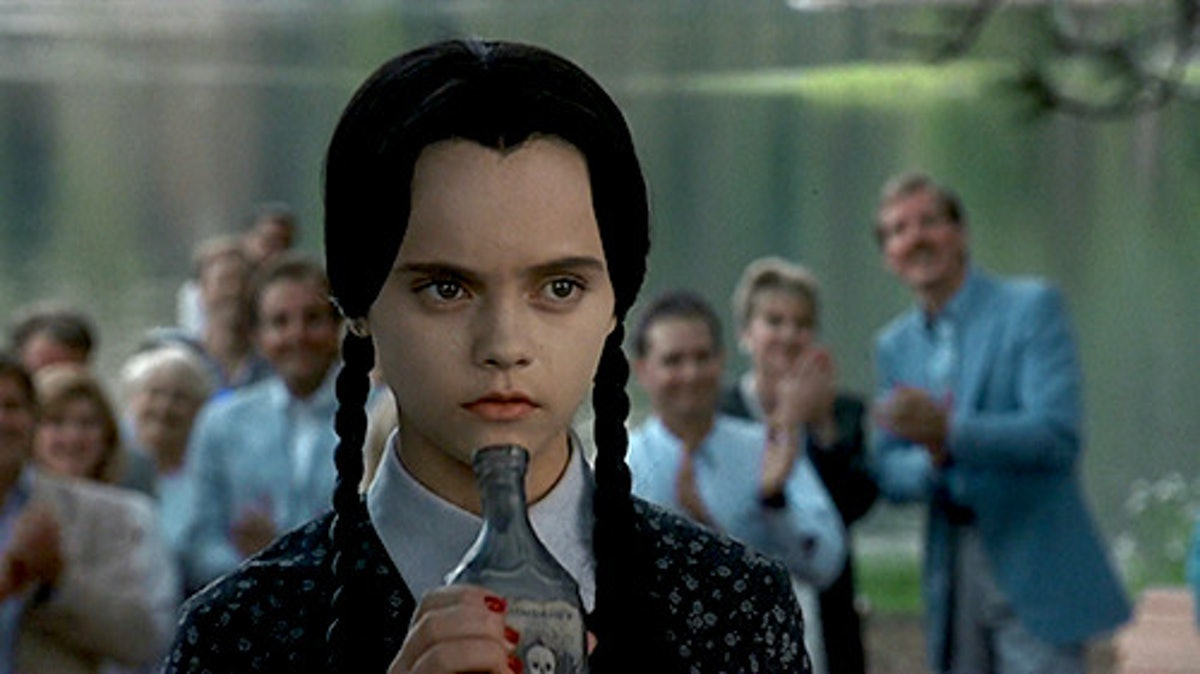 """Wednesday Addams from """"Addams Family Values"""" smelling poison."""