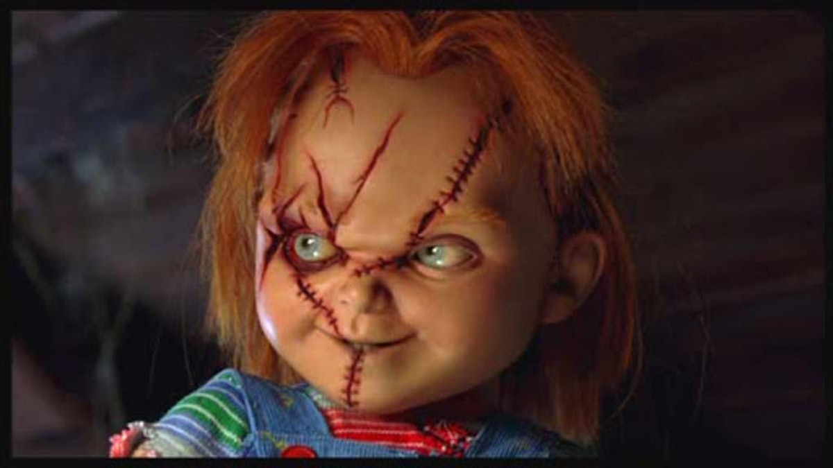 """Chucky in """"Seed"""" of Chucky"""" smiling manically."""