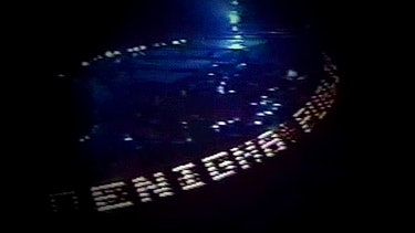 """A photo fo a Pink Floyd concert with the """"Enigma Publius"""" name in lights."""